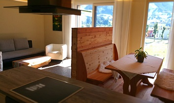 View from the kitchen (with extractor fan) to the dining table and couch, and also to the Matrei in Osttirol area
