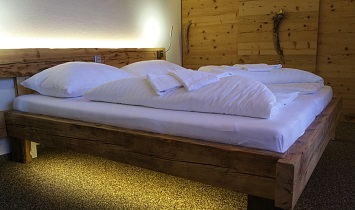 The floors in the Tradition apartments are made from stone elements, while the beds and chests are made from wood