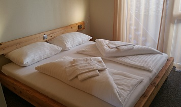 Enjoy a wonderful slumber in the bedrooms which have lots of traditional wood elements