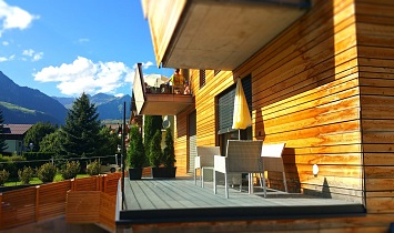 Fantastic view to the mountains in Tyrol from the balcony of the Tradition apartment Large