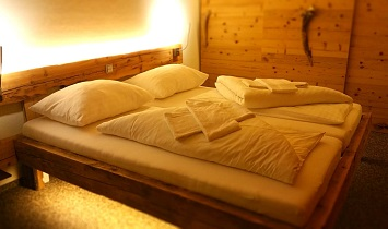 Snuggle up - in the cosy bedrooms in the Tradition apartments in SUN Matrei