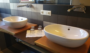 Two wash basins on wooden bases lend a traditional touch